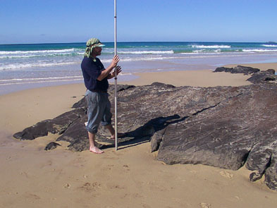 Ron-surveying-humicretes-_coffee-rocks_-on-the-eastern-beach-of-Fraser-Island